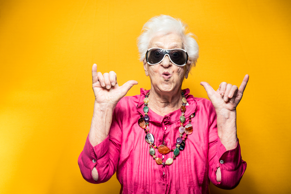 Senior Citizen in Cool Sunglasses Doing Hang Loose Sign